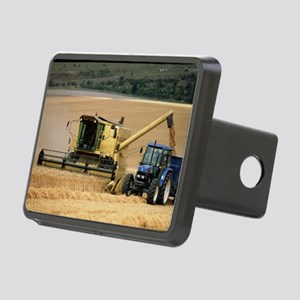 Combine harvester off-loading grain - Hitch Cover