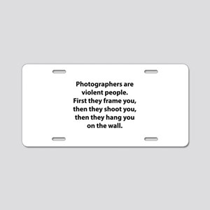Photographers are violent people. Aluminum License