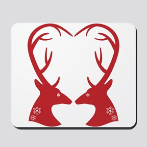 Christmas deers with heart shaped antlers Mousepad