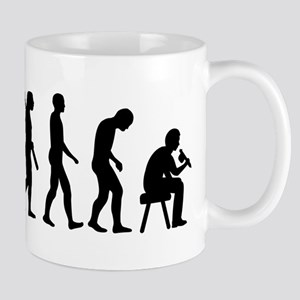 Tattoo artist evolution Mug