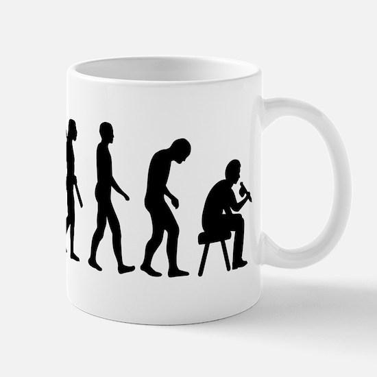 Tattoo artist evolution Mug