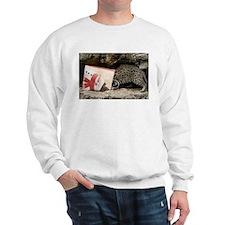 Ocelot in Snowman Bag Sweatshirt