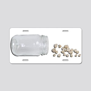 Baby teeth from a jar Aluminum License Plate