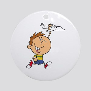 cute boy kid playing with plane Ornament (Round)