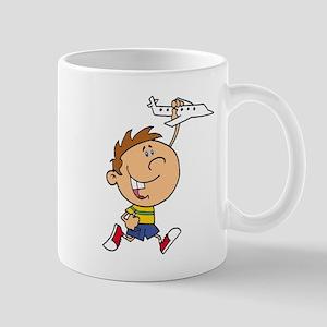 cute boy kid playing with plane Mug