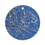 Snowy Branches Against the Sky Ornament (Round)