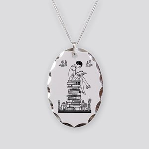 Reading Girl atop books Necklace Oval Charm