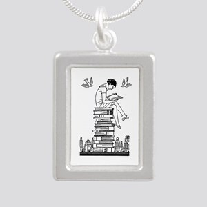 Reading Girl atop books Silver Portrait Necklace