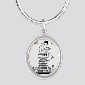 Reading Girl atop books Silver Oval Necklace