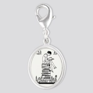 Reading Girl atop books Silver Oval Charm