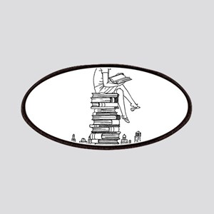 Reading Girl atop books Patches