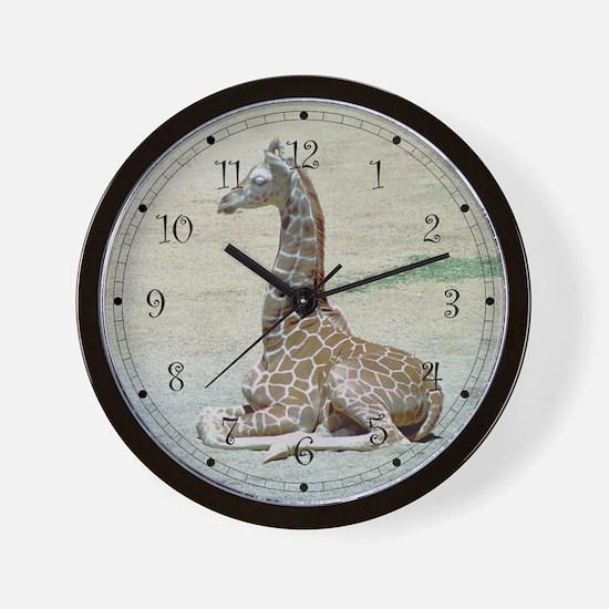 Young Giraffe at Rest Wall Clock