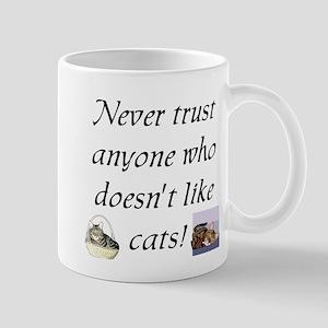 Never Trust ... Cats Mug