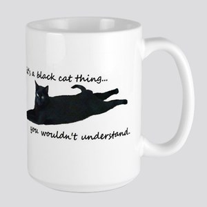 black cat thing Mugs