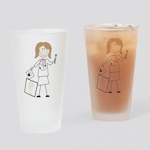 Female Audiologist Drinking Glass
