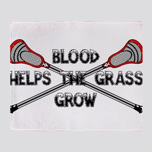 Lacrosse blood helps the grass grow Throw Blanket