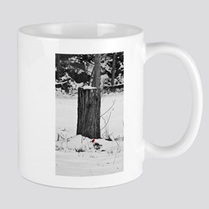 Cardinal in the snow Mug