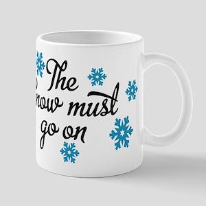 The snow must go on Mug