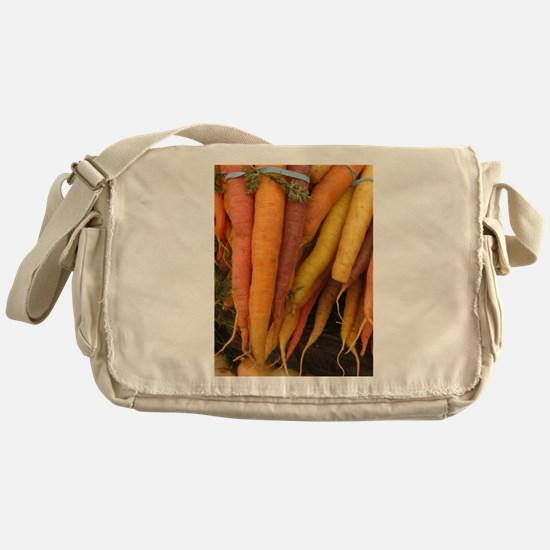 an assortment of long organic carrots in colors Me