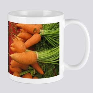 short carrots on red at a market Mug