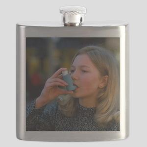 Teenager using an aerosol inhaler for asthma - Fla