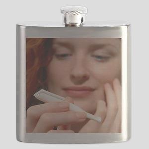Woman holds a Nicorette nicotine drug inhaler - Fl