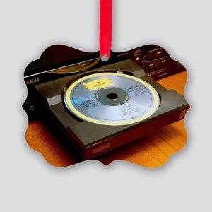 Loading a compact disc into compact disc player -