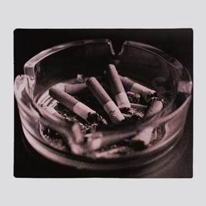 Close-up of cigarette butts and ash in an ashtray