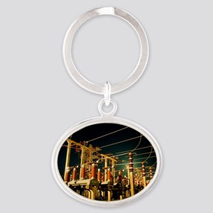 Electricity substation at night - Oval Keychain
