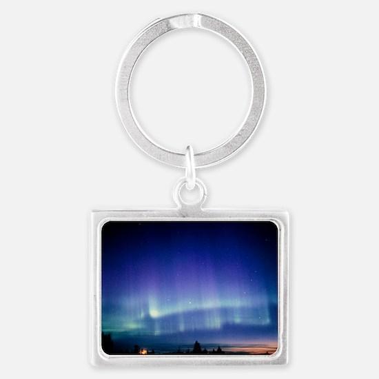 View of a colourful aurora borealis display - Land