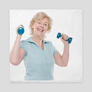 Senior woman lifting weights - Queen Duvet