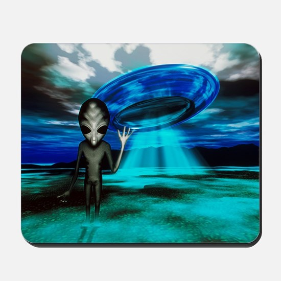 Computer artwork of an alien and a UFO - Mousepad