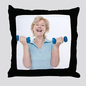 Senior woman lifting weights - Throw Pillow
