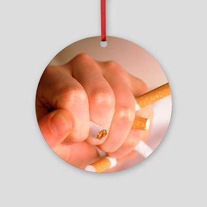 Hand crushing cigarettes - Round Ornament