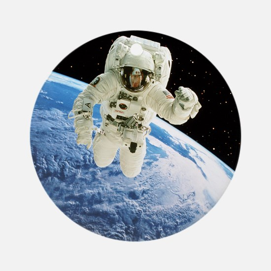 Composite image of a spacewalk over Earth - Round