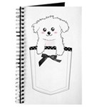 Cute puppy dog in pocket Journal