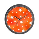 Orange and White Star Pattern Wall Clock