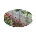 Tulips Along White Picket Fence Oval Car Magnet