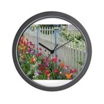 Tulips Along White Picket Fence Wall Clock
