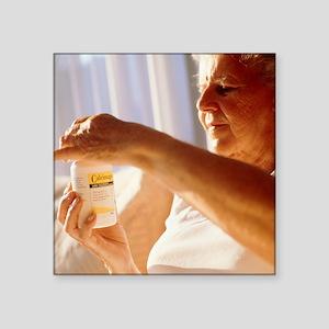 Elderly woman taking calcium pills - Square Sticke