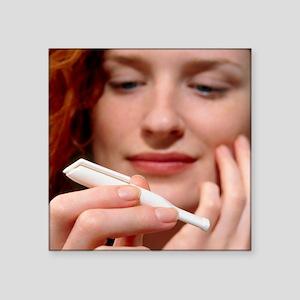 Woman holds a Nicorette nicotine drug inhaler - Sq