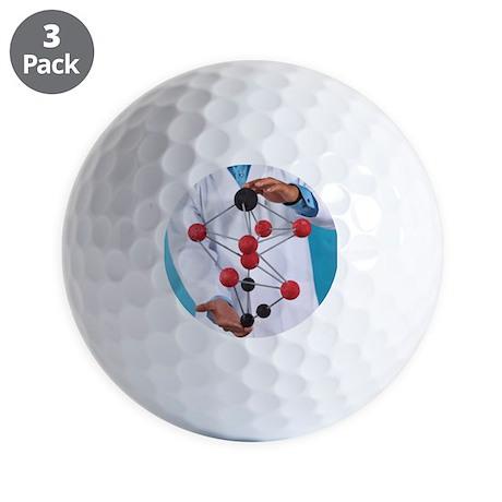 Golf Balls - Holding chemistry model