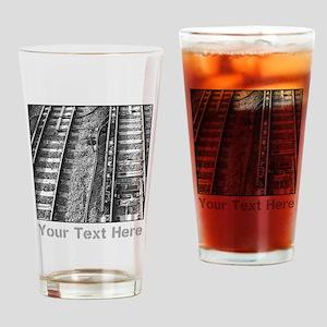 Railroad Tracks. Gray Text. Drinking Glass