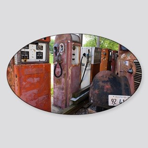Rusty gas pumps and car - Sticker (Oval)