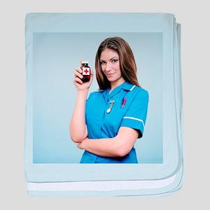 Nurse holding a bottle of pills - Baby Blanket