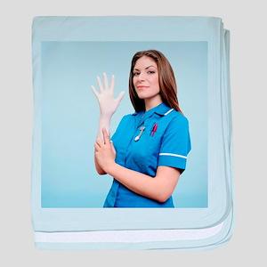 Nurse pulling on a glove - Baby Blanket