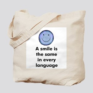 A smile is the same in every  Tote Bag