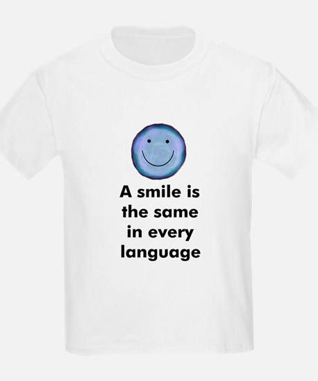 A smile is the same in every  Kids T-Shirt