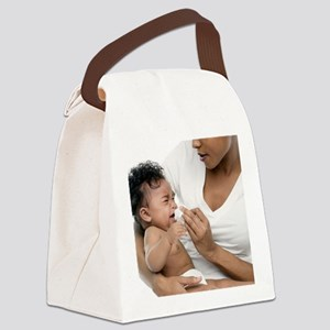 Blowing a baby's nose - Canvas Lunch Bag