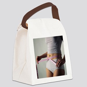 Woman measuring her waist - Canvas Lunch Bag